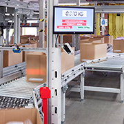 Boxes travel through checkweigh to ensure pick accuracy for Asda at its Clipper Logistics facility in Boughton