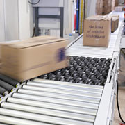 Swivel sorters in Lakeland's roller conveyor system sort parcels efficiently