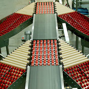 Belt conveyor as part of merging system