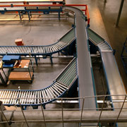 Multi stranded belt conveyor at desired angle receives products from the feed conveyor