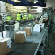 Incline conveyor transports parcels around factory