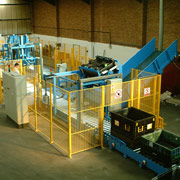 Mechanical handling system empties containers of waste, folds them in the correct sequence and stacks them ready for distribution at Ford