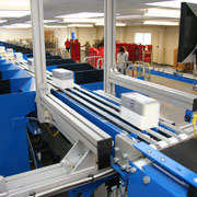Packets get transported on an incline belt conveyor to the pop-up sortation system