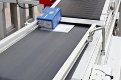 Product and paperwork are merged automatically via the double-decker conveyor before bagging, labelling and sorting