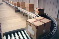 Roller conveyor transporting parcels at Faith, Rushden