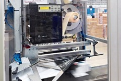 The label printer inside the bagging machine at Unipart Technology Logistics