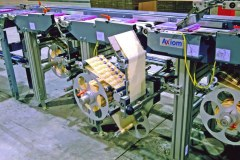 Labelling system for DVDs and other media items on a conveyor system