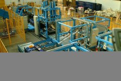 Mechanical handling line at Ford transporting folded containers to stacking area