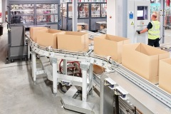 Conveyors transport empty boxes to order pickers at Asda's Boughton Facility