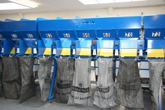 Postal sacks hang either side of the sortation system ready for filling