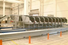 Sortation system and roller conveyor system work together to sort items into the bins