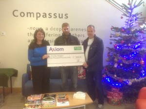 Axiom GB makes Christmas donation to St Giles Hospice