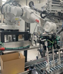 Test installation of robot and conveyor